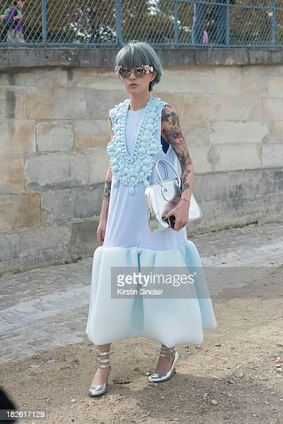 Fil wearing a Li Xiao dress Dolce and Gabanna sunglasses Vivienne Westwood shoes and a Comme Des Garcons bag on day 8 of Paris Fashion Week...