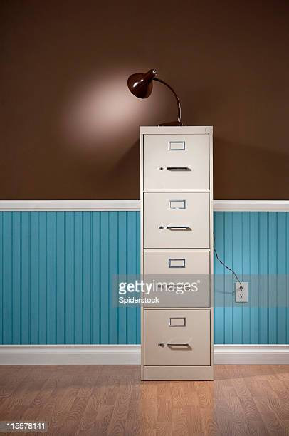 File Cabinet With Lamp In Empty Domestic Room