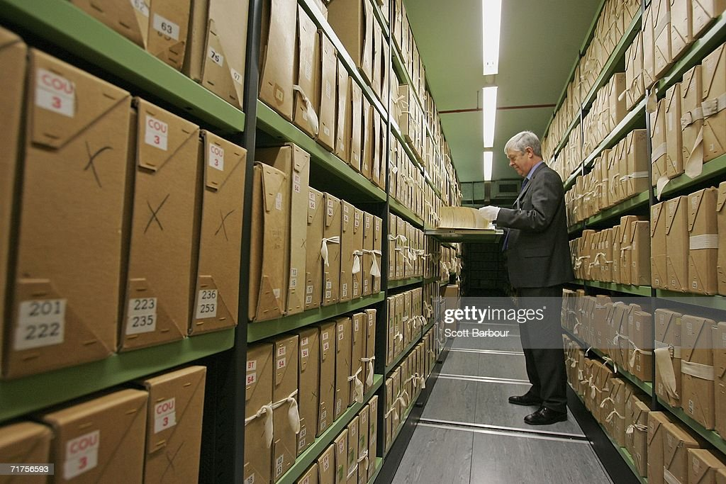 A file is removed by a member of staff from a depository at The National Archives on August 31, 2006 in London, England. The National Archives have announced the fifteenth release of Security Service records and the fourth since the full implementation of the Freedom of Information Act in January 2005. This release contains 214 files, bringing the total number of Security Service records in the public domain to well over 3,000.