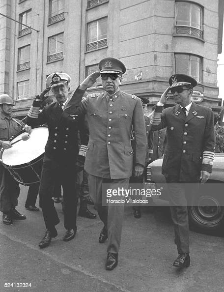 Admiral Toribio Merino General Augusto Pinochet and Air Force General Leigh salute while walking to join the Te Deum on September 18 Independence Day...