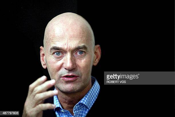 File photo dated 03 May 2002 shows Pim Fortuyn during an interview in Rotterdam Citizens placed flowers outside Rotterdam's city hall 07 May 2002 as...