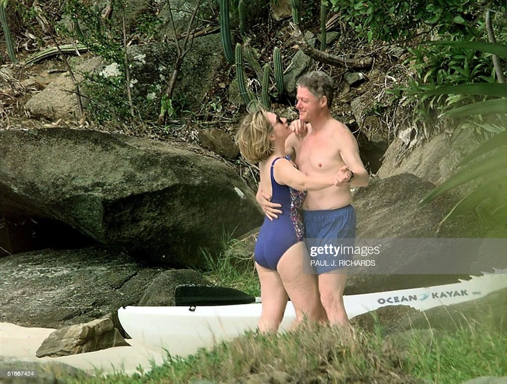 File photo dated 04 January 1998 shows US President Bill Clinton and First Lady Hillary Clinton dancing on the beach of Megan Bay, St. Thomas, US Virgin Islands shortly after taking a swim. A poll of New York voters released 05 June 2003 finds them divided on the issue of why the former First Lady Hillary Clinton penned her soon-to-be released memoirs. Twenty-eight percent said the book was meant to lay groundwork for a future presidential run, while 27 percent believe her main motivation was to 'tell her side of the story.' AFP PHOTO/PAUL J. RICHARDS