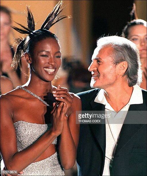 File photo dated 08 March 96 showing Italian fashion designer Gianni Versace with top model Naomi Campbell during the presentation of the...