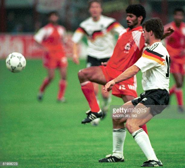 File photo dated 15 June 1990 shows Adnan alTalyani of UAE fighting for the ball with Guido Buckwald of Germany during the World Cup Group D first...