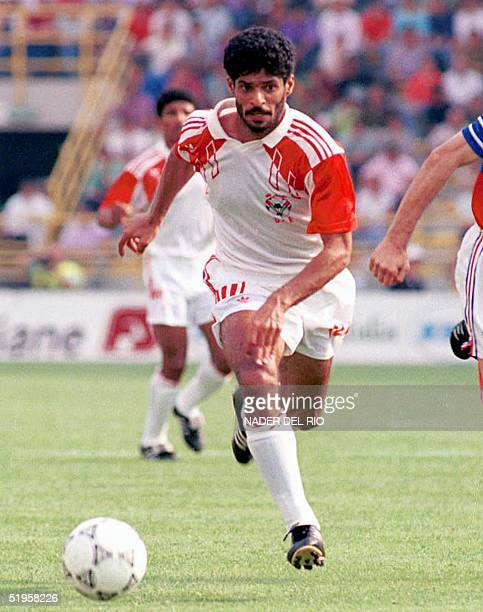 File photo dated 19 June 1990 shows Emirati forward Adnan alTalyani fighting for the ball during the World Cup Group D first round match between...