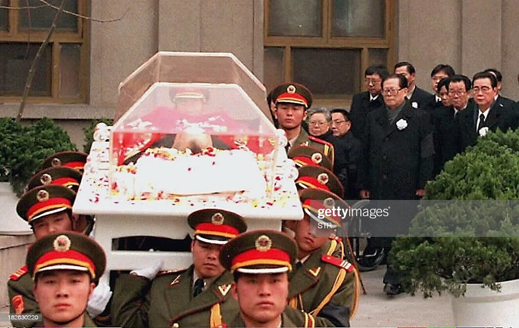 File photo dated 24 February 1997 shows the glass coffin of Chinese patriarch Deng Xiaoping carried by the honour guard as it leaves the Army...