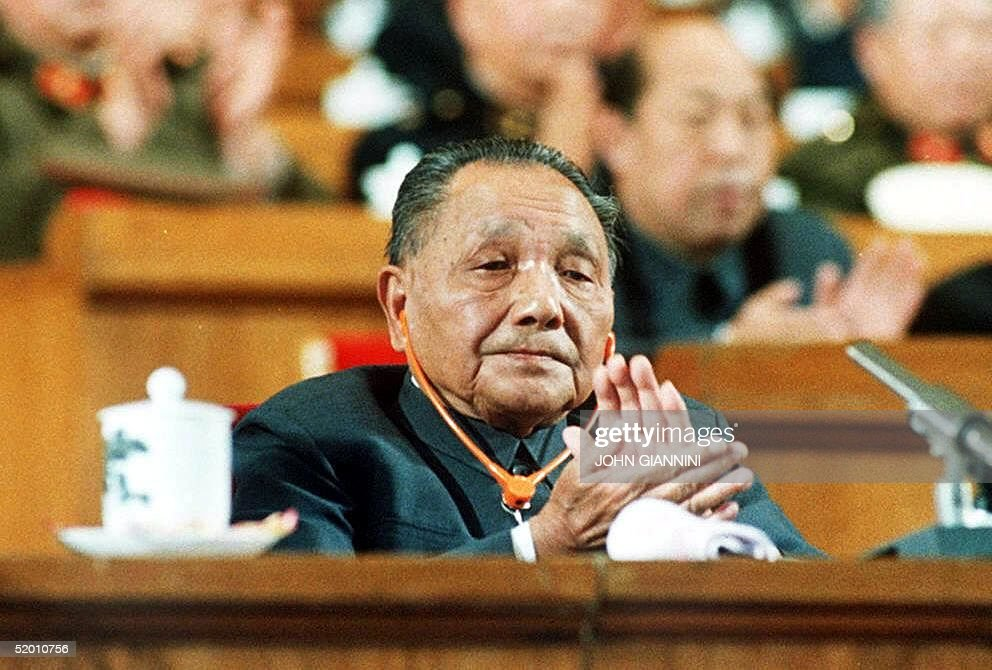 A file photo dated 25 October 1987 shows China's late political patriarch Deng Xiaoping as he applauds during a session of the National People's...