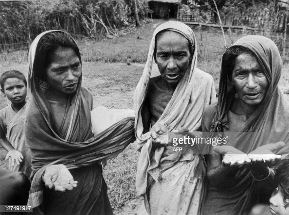 File photo dated 31 August 1974 shows three women on Hatija Island in the Bay of Bengal begging for food and supplies to reinforce the island levees...