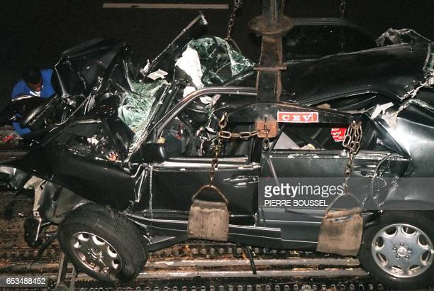 File photo dated 31 August 1997 shows a French police expert working on the wreckage of Princess Diana's car in the Alma tunnel of Paris The father...