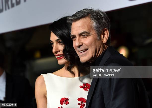 File photo dated February 1 2016 shows actor George Clooney and wife Amal at the Regency Village Theatre in Westwood California George and Amal...