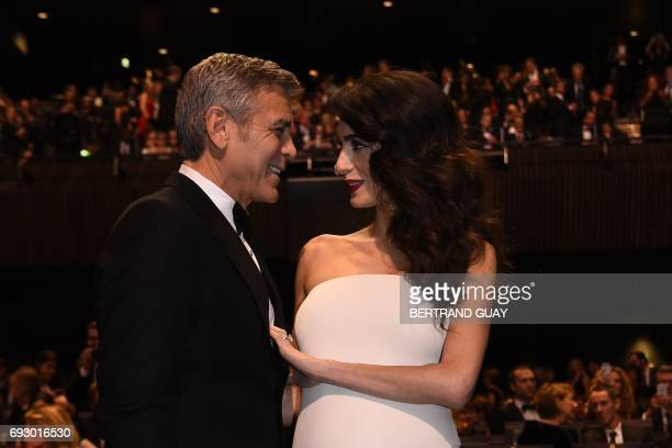 File photo dated February 24 2017 shows US actor George Clooney and his wife BritishLebanese lawyer Amal Clooney as they arrive for the 42nd edition...