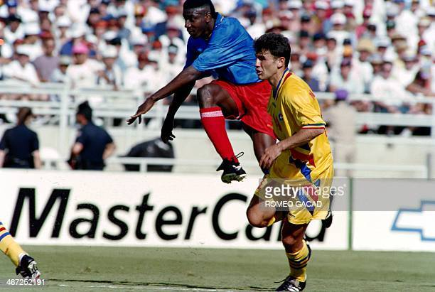 File photo dated June 18 1994 of Colombia's Adolfo Jose Valencia as he jumps beside Romanian defender Gheorghe Mihali during World Cup match in...