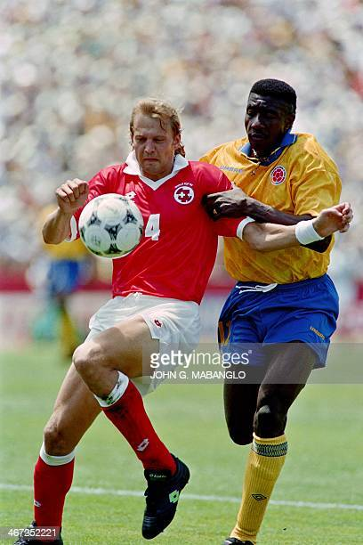 File photo dated June 26 1994 of Colombia's Adolfo Jose Valencia as he grabs Switzerland's Dominique Herr during World Cup action in Stanford CA