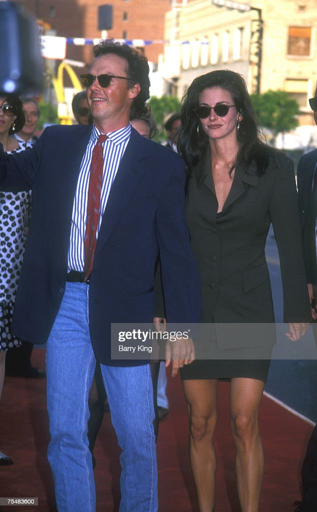 File photo of <a gi-track='captionPersonalityLinkClicked' href=/galleries/search?phrase=Michael+Keaton&family=editorial&specificpeople=206869 ng-click='$event.stopPropagation()'>Michael Keaton</a> and Courteney Cox at the World Premiere of Batman Returns at Manns Chinese Theater in Hollywood, California on June 16, 1992 during the 'Batman Returns' Hollywood Premiere at the Manns Chinese Theater in Hollywood, California.