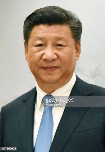 File photo shows Chinese President Xi Jinping The United States and Japan are closely watching whether China will fully enforce fresh UN sanctions...