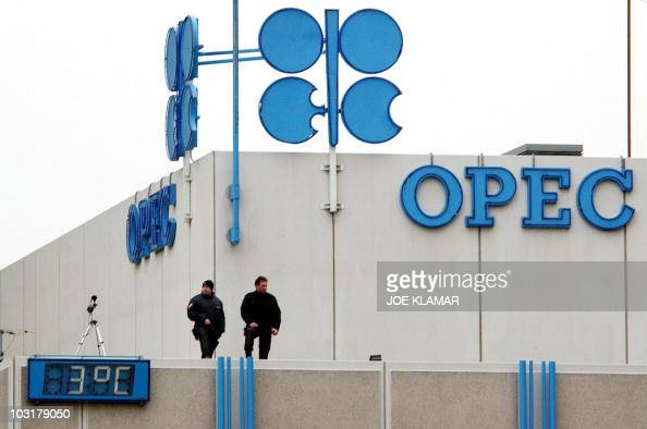 A file photo taken 04 December 2003 shows a security officer overlooking a street from a rooftop of the OPEC headquarters in Vienna where the 128th...