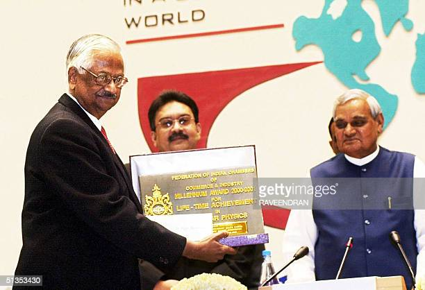 A file photo taken 16 December 2000 shows Dr Raja Ramanna a member of Parliament and the Atomic Energy Commission displaying his Federation of Indian...