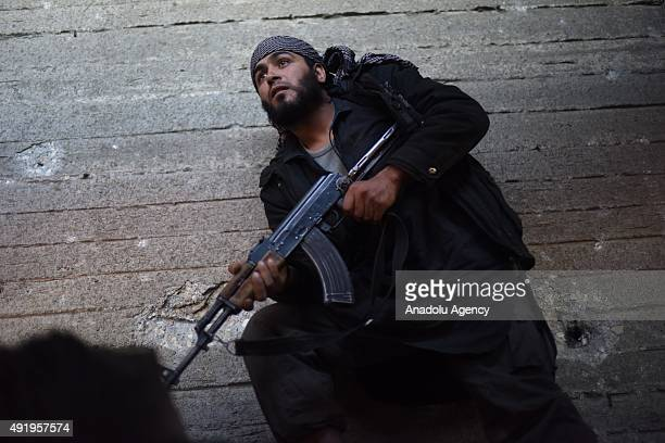 A file photo taken by AA photojournalist Saleh Mahmoud Laila shows a Syrian opposition prepares to attack Syrian regime forces in Aleppo Syria...