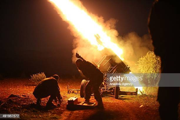 A file photo taken by AA photojournalist Saleh Mahmoud Laila shows members of The Islamic Front launching a rocket towards Syrian regime forces in...