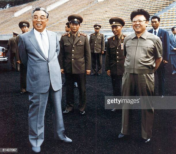 File photo taken in 1992 shows North Korean leader Kim JongIl and thenleader Jongil's father Kim IlSung inspecting a soccer ground in Pyongyang Kim...