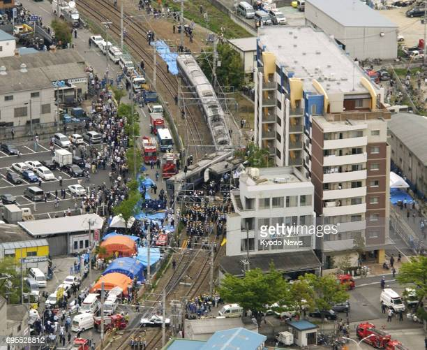 File photo taken in April 2005 shows a train derailment on the JR Fukuchiyama Line that killed 106 passengers and the driver while injuring 562 in...
