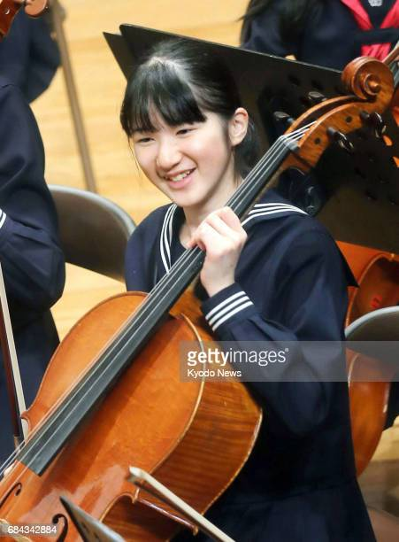 File photo taken in April 2017 shows Japanese Princess Aiko a granddaughter of Emperor Akihito taking part in a concert by an orchestra composed of...
