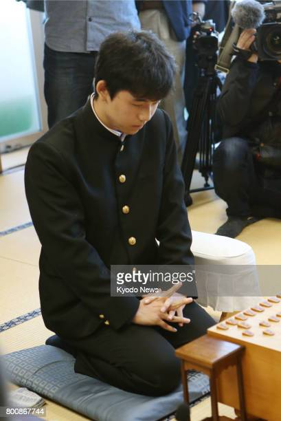 File photo taken in December 2016 shows 14yearold schoolboy Sota Fujii making his professional debut as a shogi player Fujii who has tied for the...