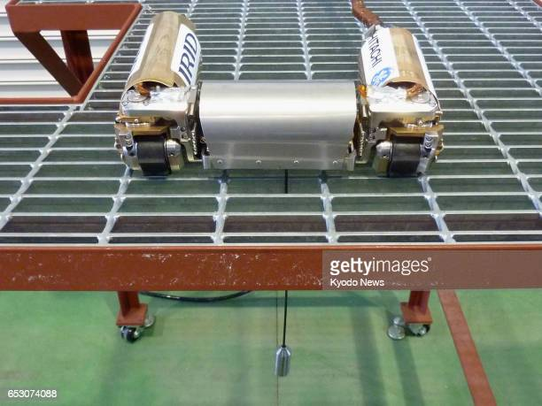File photo taken in February 2017 shows a robot that is being used to inspect conditions inside the Fukushima Daiichi nuclear plant's No 1 reactor...