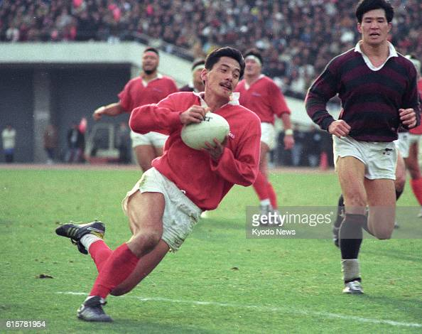 File photo taken in January 1990 shows Seiji Hirao scoring a try in Kobe Steel's win over Waseda University in the final of the national championship...