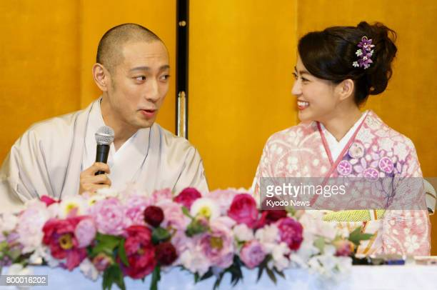 File photo taken in January 2010 shows Japanese kabuki star Ichikawa Ebizo and TV personality Mao Kobayashi attending a press conference to announce...