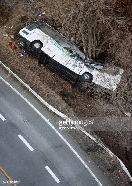 File photo taken in January 2016 shows an overturned tour bus that veered off a road in Karuizawa Nagano Prefecture in central Japan killing 13...