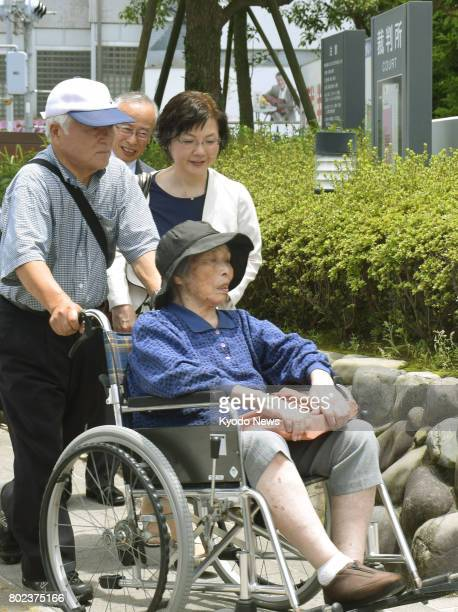 File photo taken in July 2015 shows Ayako Haraguchi in a wheelchair arriving at the Kagoshima District Court in southwestern Japan to file a petition...