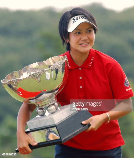 File photo taken in September 2003 shows Japanese golfer Ai Miyazato holding the trophy after winning the Miyagi TV Cup Dunlop Ladies Open in Rifu...