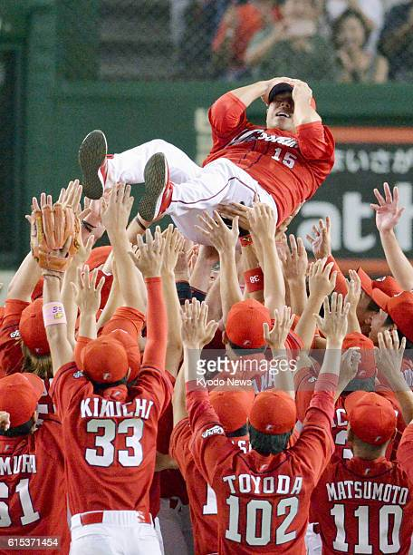 File photo taken in Tokyo in September 2016 shows Hiroshima Carp pitcher Hiroki Kuroda being thrown into the air after the team wins the Central...