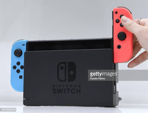 File photo taken Jan 13 in Tokyo shows Nintendo Co's new Switch game system which was launched in several major markets on March 3 Nintendo is...