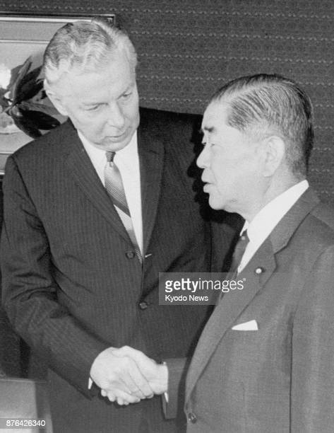 File photo taken June 25 shows US Ambassador to Japan Armin Meyer and Japanese Foreign Minister Kiichi Aichi shaking hands at the Foreign Ministry in...