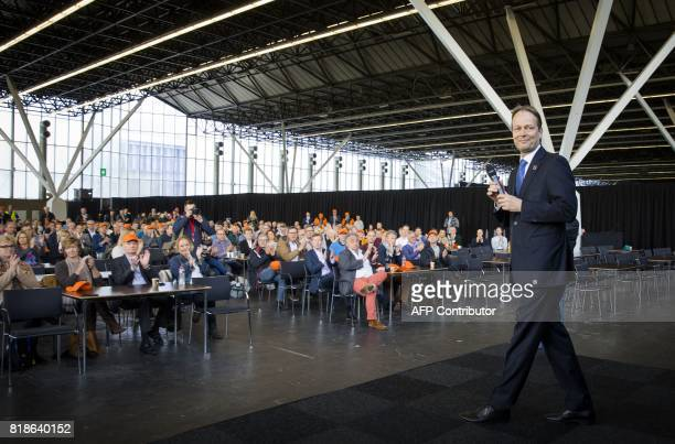A file photo taken on April 25 2017 shows Ton Buchner CEO of AkzoNobel standing on a stage during the shareholders meeting in Amsterdam the...
