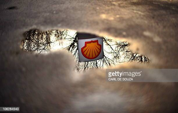 A file photo taken on Februrary 4 shows a Shell petrol station logo refelected in a puddle in London Royal Dutch Shell announced Thursday October 28...