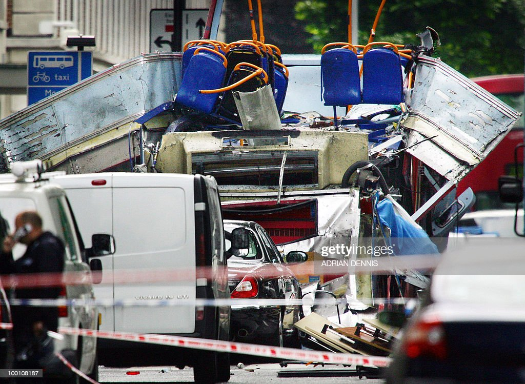 A file photo taken on July 7, 2005, shows the remains of a double-decker bus that was blown in Tavistock Square in London. An inquest into the deaths of 56 people in London's July, 2005 suicide bombings will probe the role of the police and MI5 intelligence services in the run-up to the attacks, a judge said Friday, May 21, 2010. A coroner also ruled that inquests into four suicide bombers will be held separately from those of the 52 victims, a relief to families who had protested plans to hold the inquest for killers and killed together.