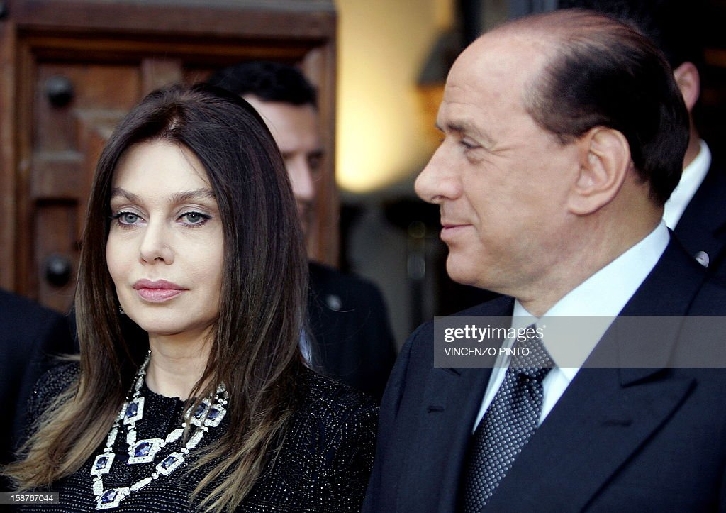 File photo taken on June 4, 2004 shows then Italian Prime Minister Silvio Berlusconi (R) and his wife Veronica Lario in Rome. Silvio Berlusconi has been ordered by an Italian court to pay his second wife Veronica Lario three million euros ($3.95 million) a month alimony as part of a legal separation settlement which opens the way for their divorce, media reports said December 28, 2012. AFP PHOTO / Vincenzo PINTO
