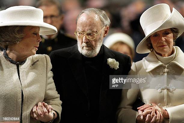 A file photo taken on March 30 2004 of Prince Bernhard assisted by his daughter Queen Beatrix and Princess Irene follows the casket bearing the...