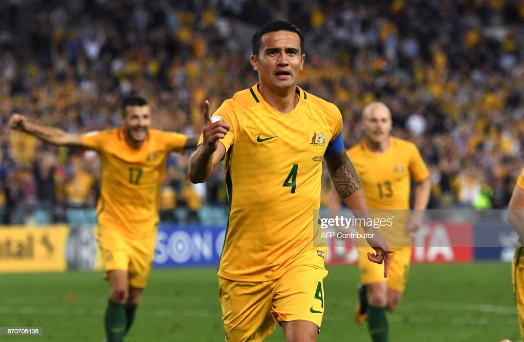 A file photo taken on October 10, 2017, shows Tim Cahill of Australia (C) celebrating with teammates after scoring against Syria during their 2018 World Cup football qualifying match against Syria played in Sydney. Goal-scoring talisman Tim Cahill took an ice machine on board the long flight to Honduras on November 6, 2017, to treat his injured ankle as he races to be fit for this week's vital World Cup playoff. The veteran Cahill, 37, said he would receive treatment from a member of Australia's medical staff during the 15-hour journey, adding that he hoped to speed up his recovery with 'round the clock work'. USE --