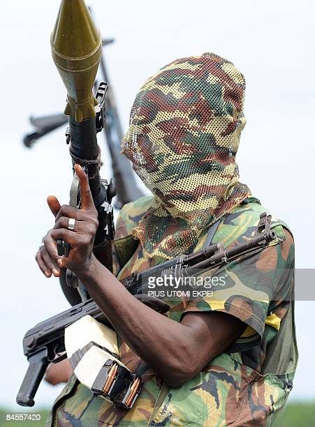 File photo taken September 17 2008 shows a fighter of the Movement for the Emancipation of the Niger Delta holding his weapons at the militia's creek...