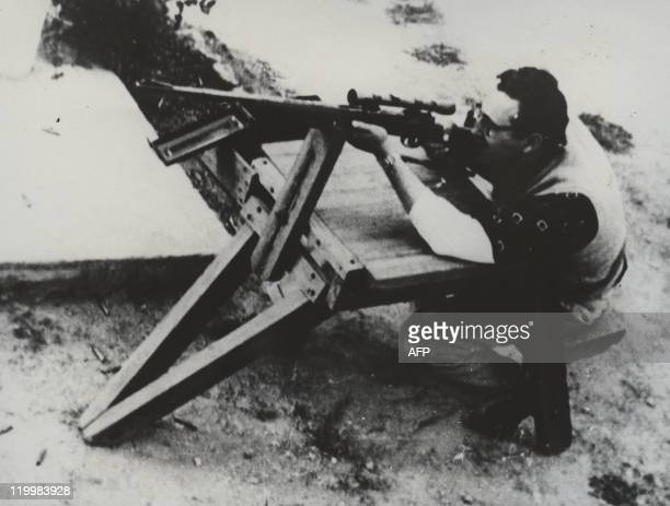 File photograph of 1956 showing Fidel Castro while practices shooting in Mexico during the preparations of 1956 uprising after disembarking from the...