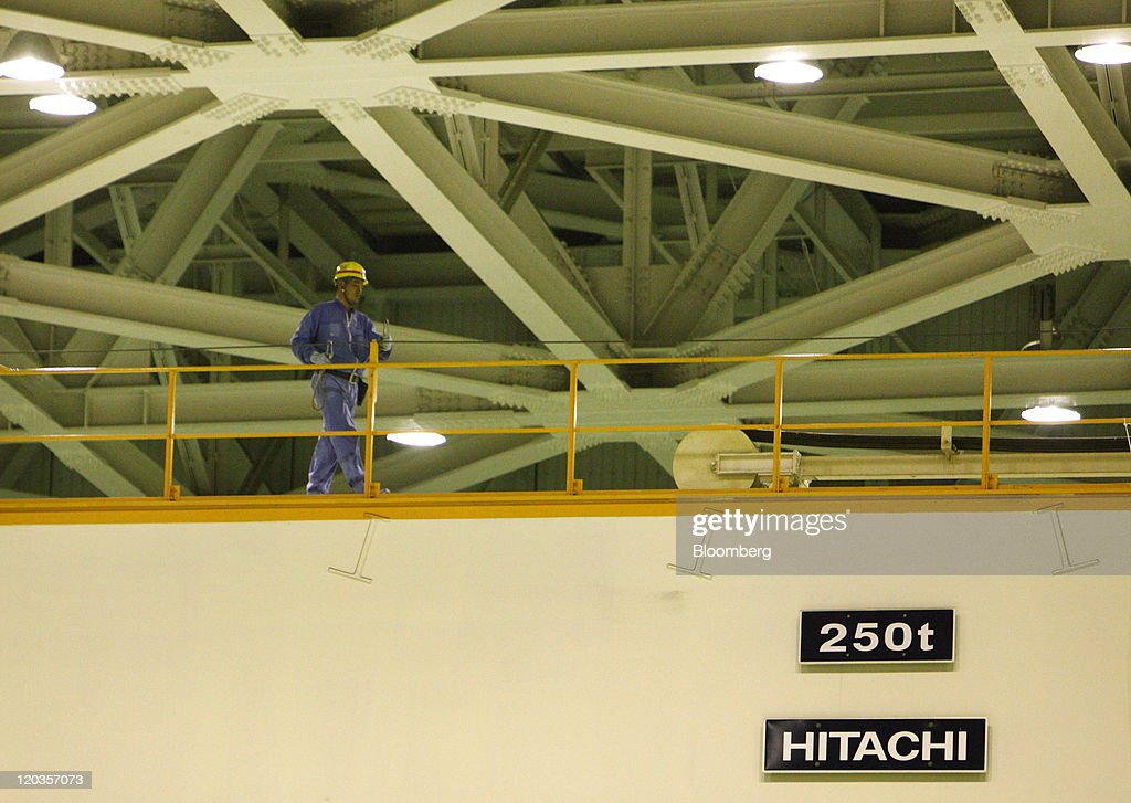 A file photograph shows the Hitachi Ltd. logo on a turbine for the No. 5 reactor at Chubu Electric Power Co.'s Hamaoka nuclear power station in Omaezaki City, Shizuoka Prefecture, Japan, on Friday, Aug. 21, 2009. Mitsubishi Heavy Industries Ltd. and Hitachi Ltd. said they're not holding talks to merge some of their businesses, hours after the president of Hitachi said that a deal was being discussed. Photographer: Tomohiro Ohsumi/Bloomberg via Getty Images