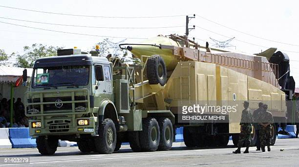 File picture dated 21 September 2004 shows a military truck carrying a longrange Iranian Shahab3 Ballistic missile during the annual military parade...