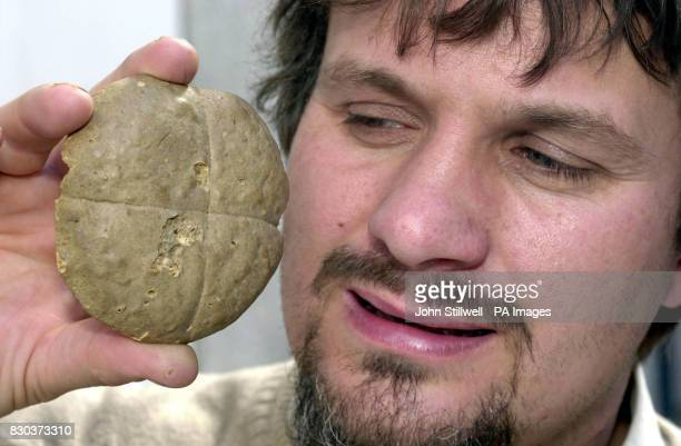 File picture dated April 17 2000 of John Shepherd eyeing up a hot cross bun which was baked 172 years ago in Stepney east London 1828 The culinary...