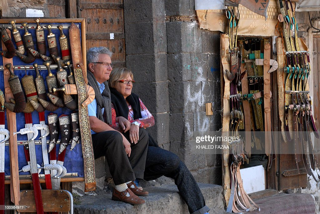 -- File picture dated December 16, 2008 shows European tourists taking a rest at the Janbeya (daggar) market in the Yemeni capital Sanaa's Old City. Tribesmen abducted a Western couple and their Yemeni driver on May 24, 2010 in Bani Mansour, 70 kilometres (45 miles) west of the capital, a tribal source told AFP.
