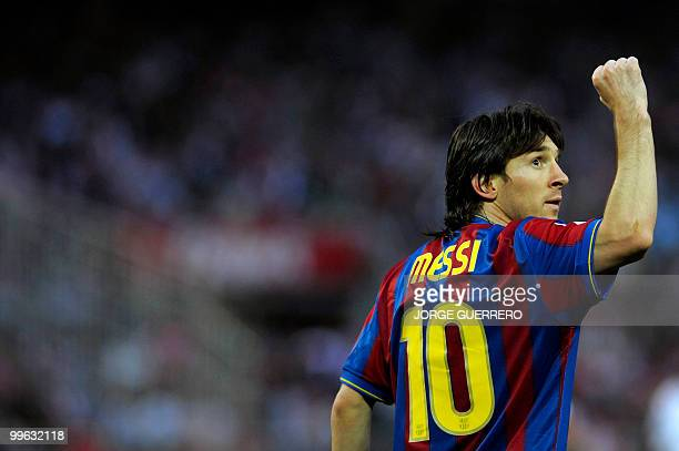 File picture dated May 8 2010 shows Barcelona's Argentinian forward Lionel Messi celebrating after scoring against Sevilla during a Spanish league...