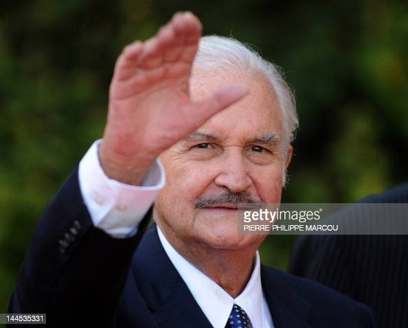 File picture dated October 13 2008 of Mexican writer Carlos Fuentes waving during the 'Don Quijote de La Mancha International Award' ceremony in...